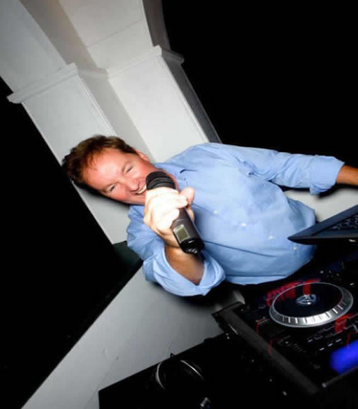 DJ Chris James mixing at a wedding